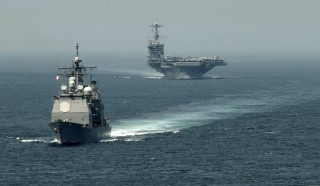 """A picture released by the US Navy shows the guided-missile cruiser USS Gettysburg (CG 64) (L) and the aircraft carrier USS Harry S. Truman (CVN 75) transiting the Strait of Gibraltar on August 3, 2013 on their way to the Mediterranean Sea. US forces are """"ready to go"""" if called on to strike the Syrian regime, Defense Secretary Chuck Hagel told the BBC on August 27, 2013, saying evidence pointed to its use of chemical weapons. The Pentagon chief said forces had been deployed as needed and President Barack Obama had reviewed military options presented by commanders. AFP PHOTO/US NAVY - Jamie Cosby === RESTRICTED TO EDITORIAL USE - MANDATORY CREDIT """"AFP PHOTO / US NAVY / Jamie Cosby"""" - NO MARKETING NO ADVERTISING CAMPAIGNS - DISTRIBUTED AS A SERVICE TO CLIENTS ==== / AFP / US NAVY FILE / Jamie Cosby"""
