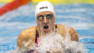 Hungary's Katinka Hosszu competes in the finals of the women's 100m medley swimming event of the 18 th European Short Course Championships in the Israeli coastal city of Netanya on December 4, 2015. AFP PHOTO / JACK GUEZ / AFP / JACK GUEZ