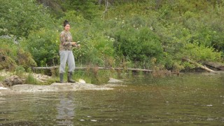 A Cree woman from Waswanipi, Canada, fishes along the Broadback River on August 19, 2015. Lead by the Cree Trappers, Waswanipi has been fighting for five years to protect 13,000 km2 (5,019 square miles) of pristine boreal forest, around the Broadback River, from the lumberjacks. But the Quebec government unveiled in July a plan that, although it would protect 5000 km2 (1,930 square miles), would also allow the forestry industry to make clear cuts on the banks of the Broadback. The Cree of Waswanipi refused such a plan and promised to fight to save their forest. AFP PHOTO/CLÉMENT SABOURIN / AFP / Clement Sabourin