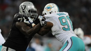 Oakland Raiders Tackle Menelik Watson (71) and Miami Dolphins Defensive End Cameron Wake (91) during the NFL International Series, Miami Dolphins versus Oakland Raiders, in London, England, on September 28, 2014. Photo Joe Toth / Backpage Images / DPPI