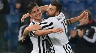 ROME, ITALY -  DECEMBER 4 : Paulo Dybala (L) of Juventus FC  celebrates after scoring a goal  during the Serie A soccer match between SS Lazio and Juventus FC at Stadio Olimpico on December 4, 2015 in Rome, Italy. Claudio Pasquazi / Anadolu Agency