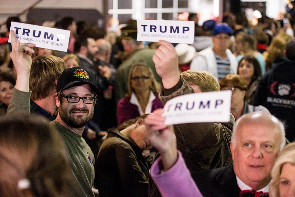 MOUNT PLEASANT, SC - DECEMBER 7:  Supporters listen as Republican presidential candidate Donald Trump speaks to the crowd Pearl Harbor Day Rally At USS Yorktown Monday, December 7, 2015, in Mt. Pleasant, South Carolina. The South Carolina Republican primary is scheduled for February 20, 2016. (Photo by Sean Rayford/Getty Images)