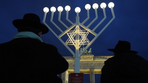 A Hanukkah candelabrum with all lights on stands on Pariser Platz in front of Brandenburg Gate in Berlin, Germany, 23 December 2014. The Hanukkah festival, which ends tonight (24 December 2014), commemorates the re-consecration of the Temple in Jerusalem in 164 B.C. Photo: Rainer Jensen/dpa