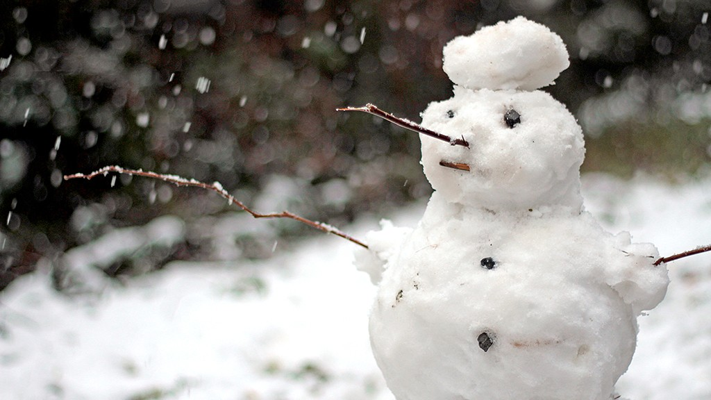 Snow man and falling snow