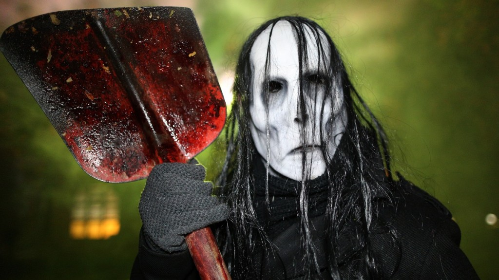 A man poses dressed as a professional frightener of the people at a Halloween Horror Fest in the Movie Park Germany in Bottrop, Germany, 29 October 2015. Photo: Ina Fassbender/dpa