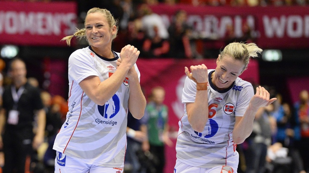 Norway's Ida Alstad (L) celebrates with her teammate Heidi Loke after scoring a goal during the 2015 Women's Handball World Championship final match between the Netherlands and Norway in Herning, Denmark on December 20, 2015.  / AFP / JONATHAN NACKSTRAND