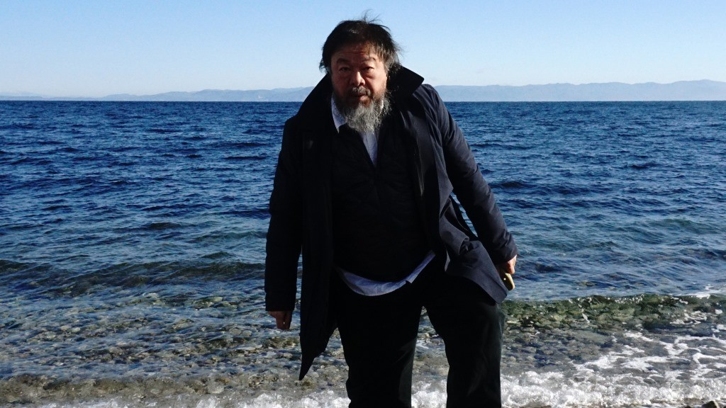 Chinese activist and artist Ai Weiwei walks on a beach near the town of Mytilene, on the Greek island of Lesbos on January 1, 2016. Chinese dissident artist Ai Weiwei paid on December 28, 2015 a holiday visit to refugees and migrants flocking to the Greek island of Lesbos, tweeting out photos and videos in appeals for their plight. / AFP / ANGELOS TZORTZINIS
