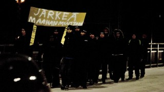 """A group that calls themselves the 'Soldiers of Odin' demonstrate with a banner reading """"Common sense to immigration"""" on January 8, 2016 in Joensuu, eastern Finland. Volunteer street patrols linked to neo-Nazi groups have emerged in several Finnish towns in recent months claiming to protect locals from what they call """"Islamic intruders"""", a trend the Finnish government condemned on Thursday. / AFP / Lehtikuva / Minna Raitavuo / Finland OUT"""