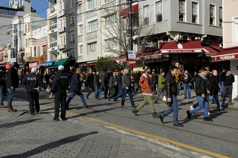 Police move people on as they secure an area at the historic Sultanahmet district of Istanbul on January 12, 2016 after an explosion.   Ten people were killed and 15 wounded in a suspected terrorist attack on Tuesday in the main tourist hub of Turkey's largest city Istanbul, officials said.A powerful blast rocked the Sultanahmet neighbourhood which is home to Istanbul's  biggest concentration of monuments and and is visited by tens of thousands of tourists every day.  / AFP / STR