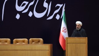 """A handout picture provided by the office of Iranian President Hassan Rouhani shows him delivering a speech during a conference entitled """"Implementation of Joint Comprehensive Plan of Action (JCPOA) a new chapter in Iran's economy"""", on January 19, 2016, in Tehran. Iran will receive $32 billion of unfrozen assets after sanctions were lifted in a deal with world powers over its nuclear programme, Iranian central bank chief Valiollah Seif said. / AFP / IRANIAN PRESIDENCY / STRINGER / RESTRICTED TO EDITORIAL USE - MANDATORY CREDIT """"AFP PHOTO / HO / IRANIAN PRESIDENCY"""" - NO MARKETING NO ADVERTISING CAMPAIGNS - DISTRIBUTED AS A SERVICE TO CLIENTS"""
