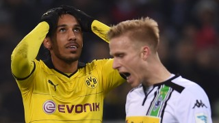 Dortmund's Gabonese striker Pierre-Emerick Aubameyang (L) reacts during the German first division football Bundesliga match Borussia Moenchengladbach vs Borussia Dortmund in Moenchengladbach, western Germany, on January 23, 2016. / AFP / PATRIK STOLLARZ / RESTRICTIONS: DURING MATCH TIME: DFL RULES TO LIMIT THE ONLINE USAGE TO 15 PICTURES PER MATCH AND FORBID IMAGE SEQUENCES TO SIMULATE VIDEO. == RESTRICTED TO EDITORIAL USE == FOR FURTHER QUERIES PLEASE CONTACT DFL DIRECTLY AT + 49 69 650050