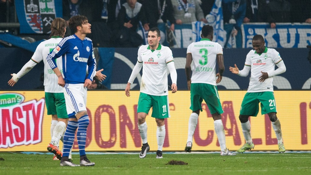 Bremen's scorer Anthony Ujah (r) reacts after 1-3 during the German Bundesliga football match FC Schalke 04 vs Werder Bremen on January 24, 2016 at Veltins-Arena in Gelsenkirchen. / AFP / dpa / Marius Becker / Germany OUT / / RESTRICTIONS: DURING MATCH TIME: DFL RULES TO LIMIT THE ONLINE USAGE TO 15 PICTURES PER MATCH AND FORBID IMAGE SEQUENCES TO SIMULATE VIDEO. == RESTRICTED TO EDITORIAL USE == FOR FURTHER QUERIES PLEASE CONTACT DFL DIRECTLY AT + 49 69 650050