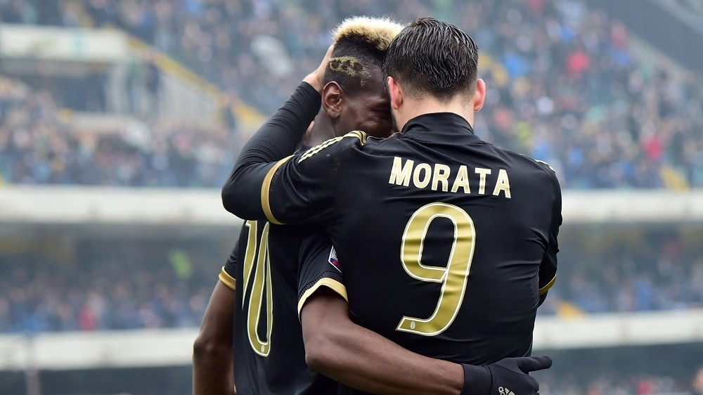 Juventus' midfielder from France Paul Pogba celebrates after scoring a goal with Juventus' forward from Spain Alvaro Morata (R) during the Serie A football match between Chievo Verona and Juventus on January 31, 2016 at Bentegodi Stadium in Verona.  / AFP / GIUSEPPE CACACE