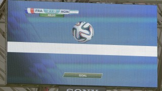 A giant screen in the stadium gives a goal using the new goal line technology during a Group E football match between France and Honduras at the Beira-Rio Stadium in Porto Alegre during the 2014 FIFA World Cup on June 15, 2014.  AFP PHOTO / FRANCK FIFE / AFP / FRANCK FIFE