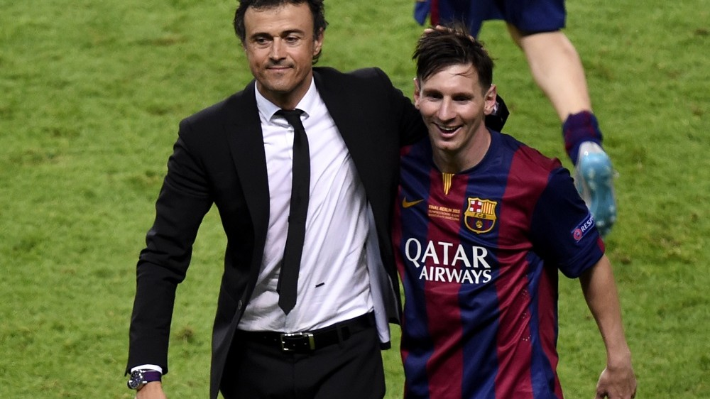 Barcelona's coach Luis Enrique and Barcelona's Argentinian forward Lionel Messi (R) celebrate after winning the UEFA Champions League Final football match between Juventus and FC Barcelona at the Olympic Stadium in Berlin on June 6, 2015.            AFP PHOTO / ODD ANDERSEN / AFP / ODD ANDERSEN