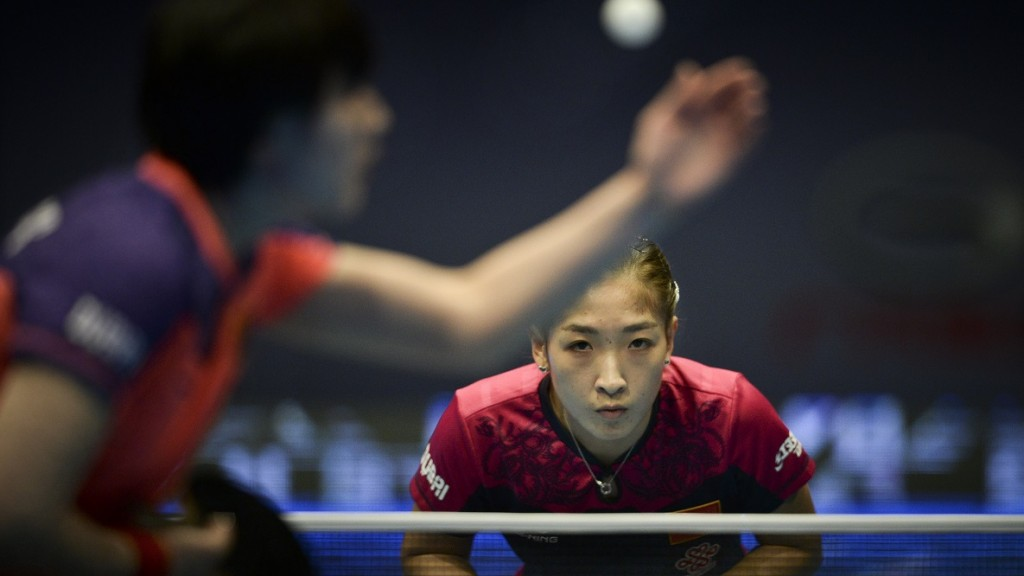 Yuling Zhu of China waits for the service of Kasumi Ishikawa of Japan during the women's single quarter final match of the 2015 ITTF World Tour Grand Finals in Odivelas, on December 12, 2015.     AFP PHOTO / PATRICIA DE MELO MOREIRA / AFP / PATRICIA DE MELO MOREIRA