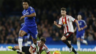 Chelsea's French striker Loic Remy (L) jumps a tackle by Sunderland's English defender Billy Jones during the English Premier League football match between Chelsea and Sunderland at Stamford Bridge in London on December 19, 2015.  AFP PHOTO / IAN KINGTON RESTRICTED TO EDITORIAL USE. NO USE WITH UNAUTHORIZED AUDIO, VIDEO, DATA, FIXTURE LISTS, CLUB/LEAGUE LOGOS OR 'LIVE' SERVICES. ONLINE IN-MATCH USE LIMITED TO 75 IMAGES, NO VIDEO EMULATION. NO USE IN BETTING, GAMES OR SINGLE CLUB/LEAGUE/PLAYER PUBLICATIONS. / AFP / IAN KINGTON