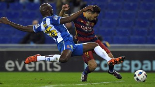 Barcelona's forward Munir El Haddadi (R) shoots to score a goal next to Espanyol's French defender Michael Ciani (L) during the Spanish Copa del Rey (King's Cup) round of 16 second leg football match RCD Espanyol vs FC Barcelona at Cornella-El Prat stadium in Cornella near Barcelona, on January 13, 2016. AFP PHOTO/ LLUIS GENE / AFP / LLUIS GENE