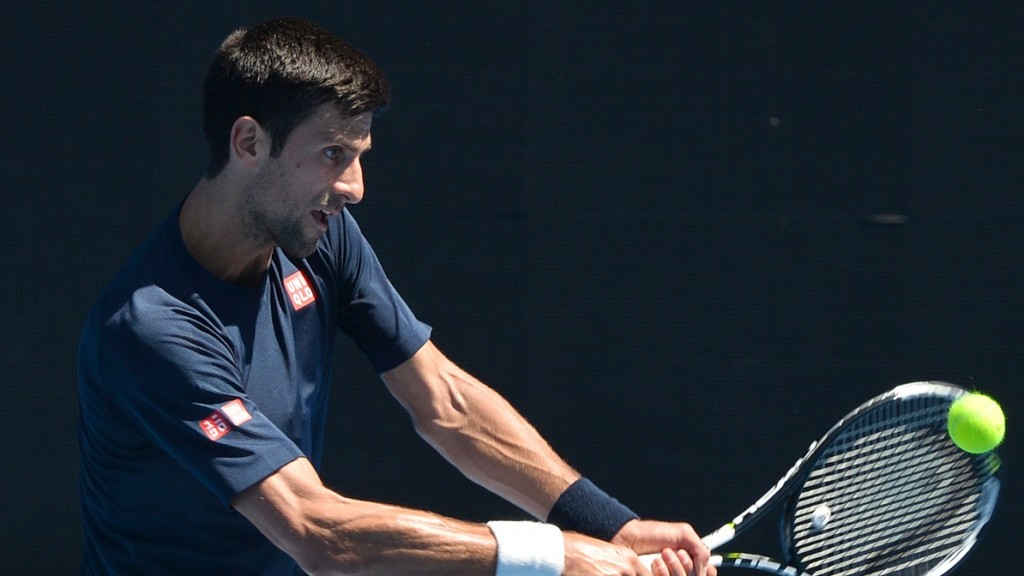 Serbia's Novak Djokovic plays a backhand return during a practice session ahead of the 2016 Australian Open tennis tournament in Melbourne on January 16, 2016. AFP PHOTO / PAUL CROCK- IMAGE RESTRICTED TO EDITORIAL USE - STRICTLY NO COMMERCIAL USE / AFP / PAUL CROCK