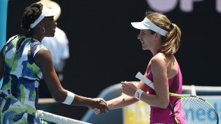 Britain's Johanna Konta (R) shakes hands as she celebrates after victory in her women's singles match against Venus Williams of the US on day two of the 2016 Australian Open tennis tournament in Melbourne on January 19, 2016. AFP PHOTO / WILLIAM WEST-- IMAGE RESTRICTED TO EDITORIAL USE - STRICTLY NO COMMERCIAL USE / AFP / WILLIAM WEST