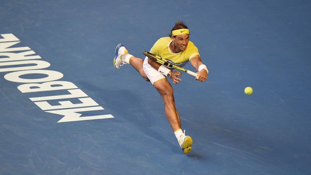 Spain's Rafael Nadal plays a forehand return during his men's singles match against compatriot Fernando Verdasco on day two of the 2016 Australian Open tennis tournament in Melbourne on January 19, 2016.  / AFP / WILLIAM WEST