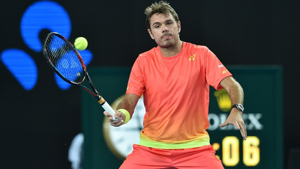 Switzerland's Stanislas Wawrinka plays a forehand return during his men's singles match against Russia's Dmitry Tursunov on day two of the 2016 Australian Open tennis tournament in Melbourne on January 19, 2016. AFP PHOTO / SAEED KHAN-- IMAGE RESTRICTED TO EDITORIAL USE - STRICTLY NO COMMERCIAL USE / AFP / SAEED KHAN