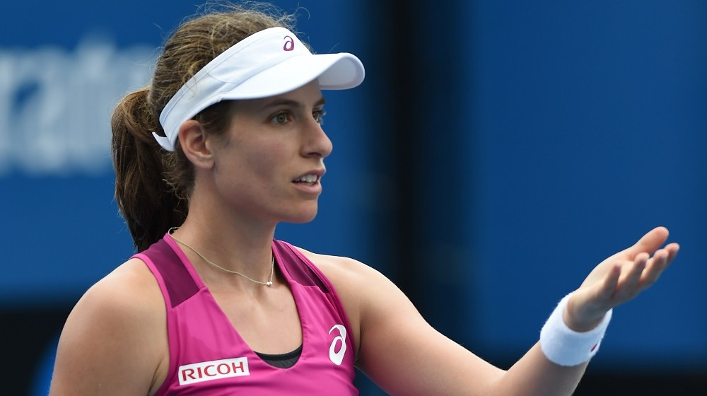 Britain's Johanna Konta gestures during her women's singles match against China's Zheng Saisai on day four of the 2016 Australian Open tennis tournament in Melbourne on January 21, 2016. AFP PHOTO / GREG WOOD-- IMAGE RESTRICTED TO EDITORIAL USE - STRICTLY NO COMMERCIAL USE / AFP / GREG WOOD