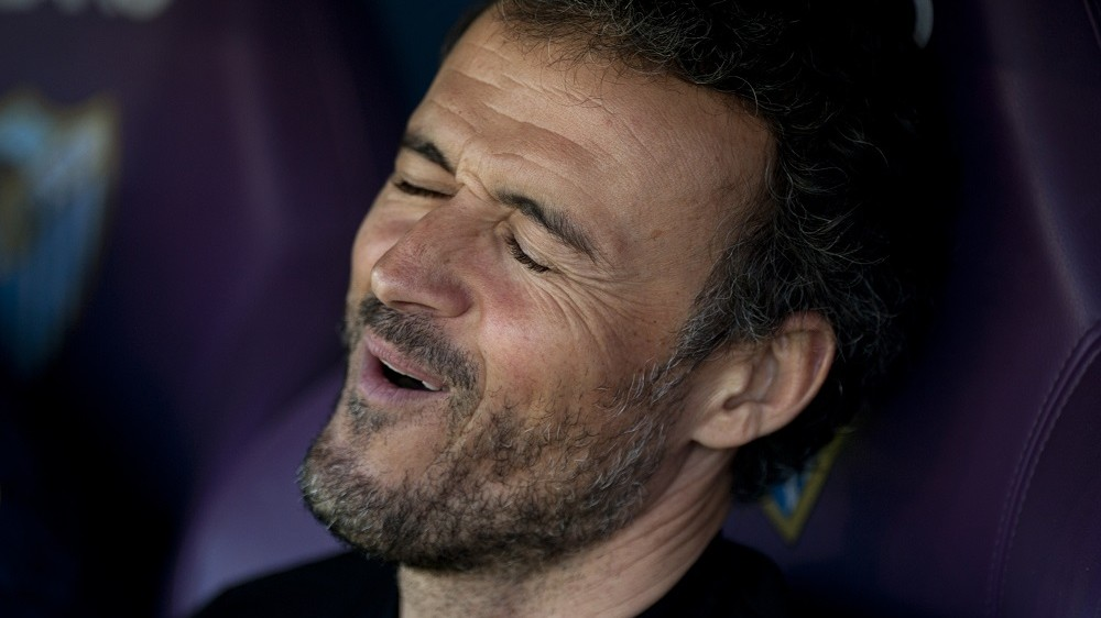 Barcelona's coach Luis Enrique Martinez grimaces before the Spanish league football match Malaga CF vs FC Barcelona at La Rosaleda stadium in Malaga on January 23, 2016.   AFP PHOTO / JORGE GUERRERO / AFP / Jorge Guerrero