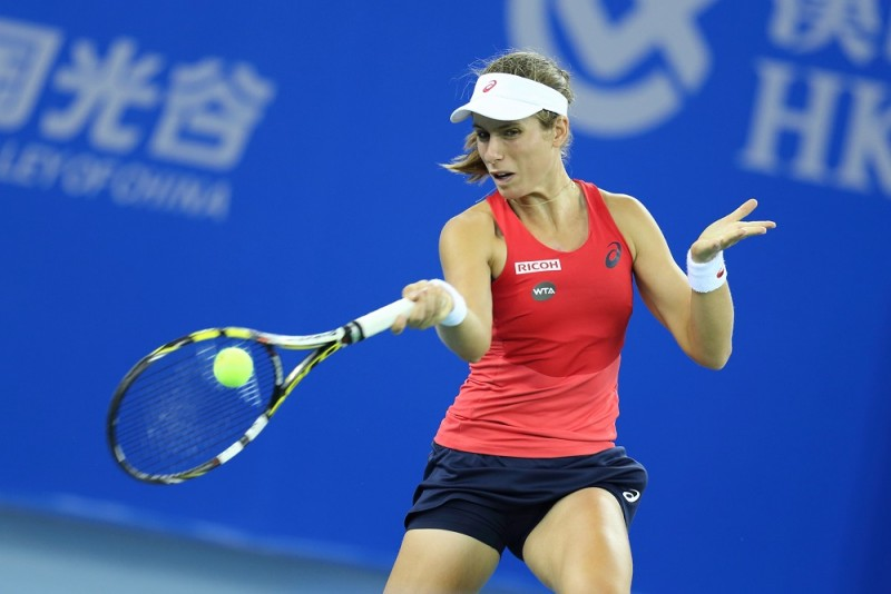 Johanna Konta of the United Kingdom returns a shot to Venus Williams of the United States in their quarter-final match of the women's singles during the 2015 WTA Wuhan Open tennis tournament in Wuhan city, central China's Hubei province, 1 October 2015.