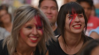 ARGENTINA, Buenos Aires: Bowie's fans wears tribute make-up during a projection of films and videos about the British singer held on Vaticano square in Buenos Aires, Argentina on January 13, 2016. David Bowie has died aged 69 of cancer just two days after releasing a new album. - CITIZENSIDE/ANTON VELIKZHANIN