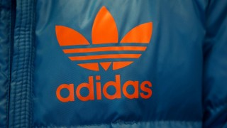 The logo of the sports clothing and accessories  company adidas is seen on a jacket in Herzogenaurach, Germany, 30 October 2013. Photo: Daniel Karmann/dpa