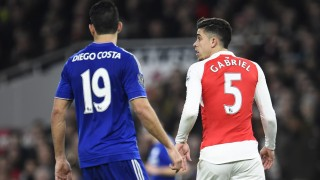 Gabriel Paulista of Arsenal looks over his shoulder as Diego Costa of Chelsea lurks behind him during the Barclays Premier League match between Arsenal and Chelsea played at The Emirates Stadium, London on January 24th 2015 - Photo Javier Garcia / BPI / DPPI