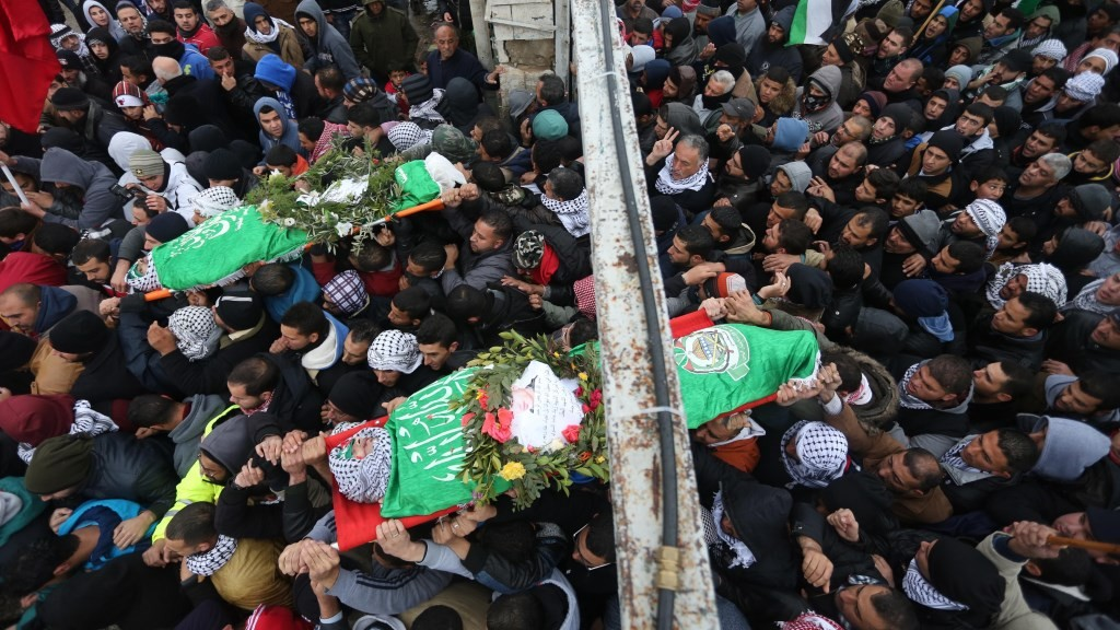 RAMALLAH, WEST BANK - JANUARY 3: (EDITORS NOTE: Image depicts death.) Palestinians carry the bodies of Muhammed Ayad and Enes Hammad, who were shot dead by Israeli soldiers after they allegedly drive their cars onto them, during a funeral ceremony at the Silwad town of Ramallah, West Bank on January 3, 2016. Issam Rimawi / Anadolu Agency