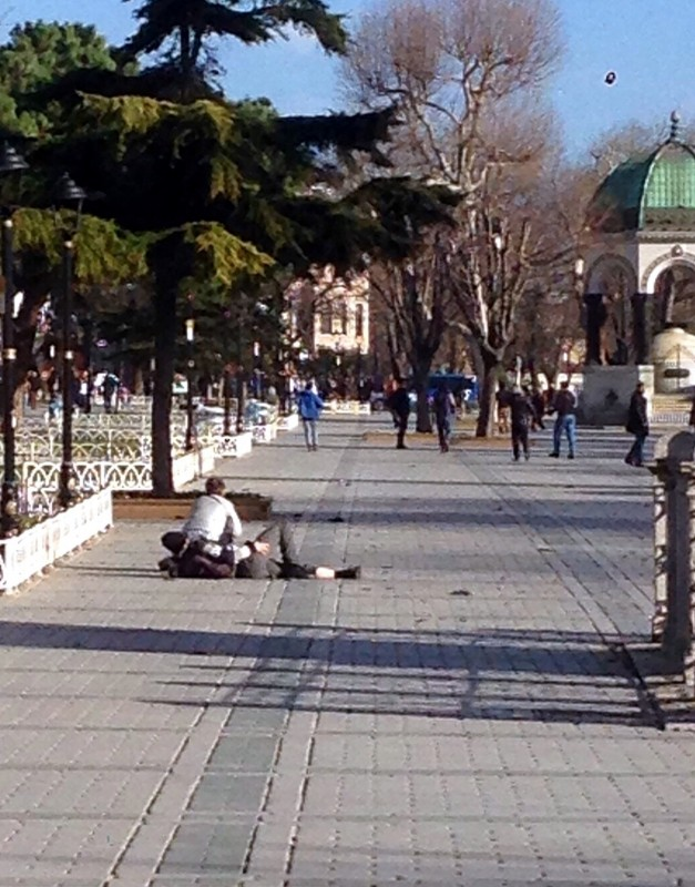 ISTANBUL, TURKEY - JANUARY 12: A wounded man is seen on the ground at the Sultanahmet tourist district after an explosion in Istanbul, Turkey on January 12, 2016. Turkish police have sealed off central Istanbul square in historic Sultanahmet district after the explosion was heard. Ambulances raced to the scene in the minutes after the explosion.  Arif Hudaverdi Yaman / Anadolu Agency