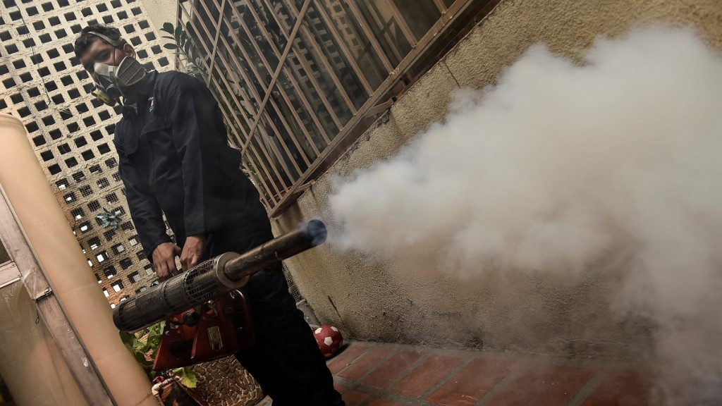 VENEZUELA, CARACAS - JANUARY 28  : A health employee fumigates against Aedes Aegypti mosquito on January 28, 2016. Venezuela has recorded 4,700 suspected cases of people infected by the Zika virus, which is thought to cause brain damage in babies, the health ministry said on Thursday. Carlos Becerra / Anadolu Agency