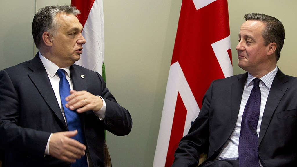 British Prime Minister David Cameron (R) speaks with Hungarian Prime Minister Viktor Orban during a meeting on the sidelines of an EU summit in Brussels on December 18, 2015.   / AFP / POOL / Virginia Mayo