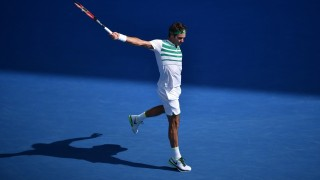 Switzerland's Roger Federer plays a backhand return during his men's singles match against Czech Republic's Tomas Berdych on day nine of the 2016 Australian Open tennis tournament in Melbourne on January 26, 2016. AFP PHOTO / PETER PARKS-- IMAGE RESTRICTED TO EDITORIAL USE - STRICTLY NO COMMERCIAL USE / AFP / PETER PARKS