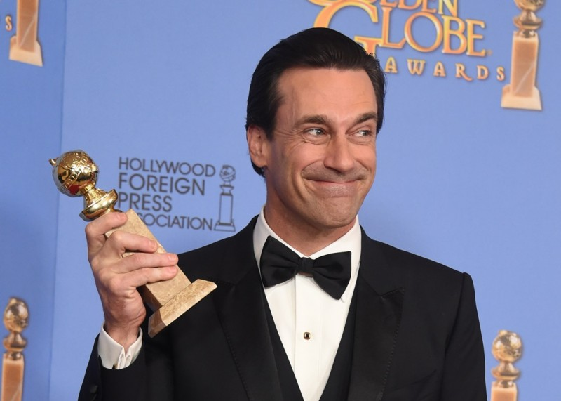 "Jon Hamm poses with his award for Best Actor in a Television Series - Drama for his role in ""Mad Men,"" in the press room at the 73nd annual Golden Globe Awards, January 10, 2016, at the Beverly Hilton Hotel in Beverly Hills, California. AFP PHOTO / FREDERIC J. BROWN / AFP / FREDERIC J BROWN"