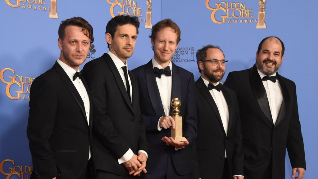 "Director Laszlo Nemes (C) and actor Geza Rohrig (2L) and other members of the ""Son of Saul"" team pose with the award for Best Foreign Language film for ""Son of Saul,"" in the press room at the 73nd annual Golden Globe Awards, January 10, 2016, at the Beverly Hilton Hotel in Beverly Hills, California. AFP PHOTO / FREDERIC J. BROWN / AFP / FREDERIC J BROWN"