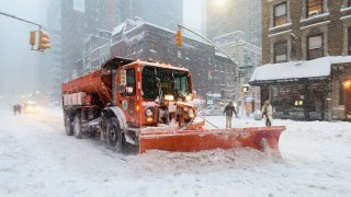 A snowplow clears snow on Lexington Avenue during the snowstorm January 2016 in New York.A deadly blizzard with bone-chilling winds and potentially record-breaking snowfall slammed the eastern US on Saturday, as officials urged millions in the storm's path to seek shelter -- warning the worst is yet to come. / AFP / FRANCOIS XAVIER MARIT