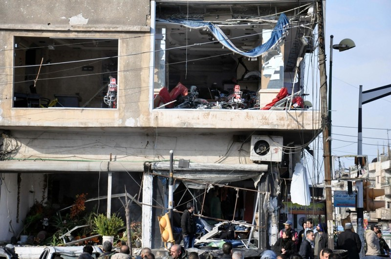 """A handout picture released by the official Syrian Arab News Agency (SANA) on January 26, 2016, shows the aftermath of a double suicide bomb blast that targeted an army checkpoint in Homs' Al-Zahraa neighbourhood. / AFP / SANA / STRINGER /  == RESTRICTED TO EDITORIAL USE - MANDATORY CREDIT """"AFP PHOTO / HO / SANA"""" - NO MARKETING NO ADVERTISING CAMPAIGNS - DISTRIBUTED AS A SERVICE TO CLIENTS =="""