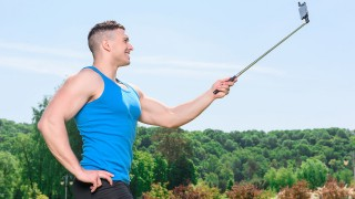 Muscled sportsman during training