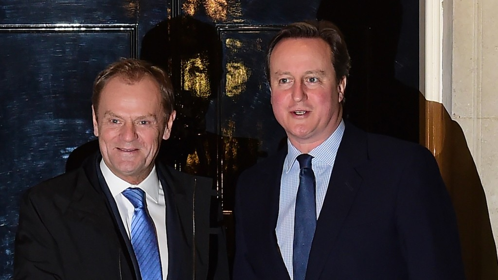 """British Prime Minister David Cameron (R) greets European Council President Donald Tusk outside No 10 Downing Street in central London on January 31, 2016, ahead of their meeting. Prime Minister David Cameron is to propose curbing the benefits European Union migrants can claim in negotiations with EU president Donald Tusk ahead of a referendum on whether Britain should leave the bloc. Under Cameron's proposal, an """"emergency brake"""" to in-work benefits would come into force immediately after the referendum, due to be held by 2017.  / AFP / Leon Neal"""