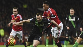 Stoke City's English-born Scottish defender Phil Bardsley (C) vies with Manchester United's French striker Anthony Martial (R) during the English Premier League football match between Manchester United and Stoke City at Old Trafford in Manchester, north west England, on February 2, 2016. / AFP / PAUL ELLIS / RESTRICTED TO EDITORIAL USE. No use with unauthorized audio, video, data, fixture lists, club/league logos or 'live' services. Online in-match use limited to 75 images, no video emulation. No use in betting, games or single club/league/player publications.  /