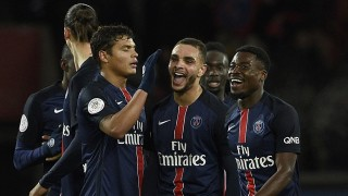 Paris Saint-Germain's French defender  Layvin Kurzawa (C) is congratuled by teammates French defender Serge Aurier (R) and Brazilian defender Thiago Silva (L) after scoring a goal during the French L1 football match between Paris Saint-Germain (PSG) vs Lorient on February 3, 2016 at the Parc des Princes stadium in Paris.  / AFP / FRANCK FIFE