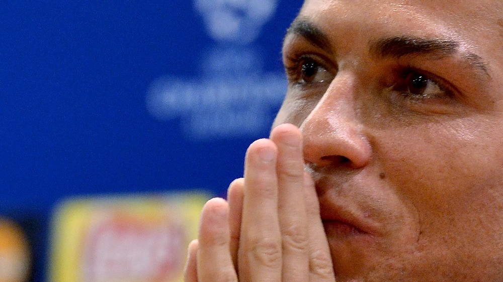 Real Madrid's Portuguese forward Cristiano Ronaldo listens to journalists' questions during a press conference at the Olympic Stadium in Rome on February 16, 2016, on the eve of their UEFA Champions League round of sixteen first leg football match against AS Roma. / AFP / TIZIANA FABI