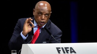 FIFA presidential contender South Africa's Tokyo Sexwale delivers a speech at the FIFA electoral congress on February 26, 2016 in Zurich. FIFA members will elect on February 26, 2016 a new president and pass reforms they hope will open an escape route from a storm of scandal symbolised by the downfall of veteran leader Sepp Blatter.  / AFP / OLIVIER MORIN