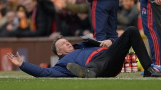 Manchester United's Dutch manager Louis van Gaal falls over on the touchline during the English Premier League football match between Manchester United and Arsenal at Old Trafford in Manchester in north west England on February 28, 2016. / AFP / OLI SCARFF / RESTRICTED TO EDITORIAL USE. No use with unauthorized audio, video, data, fixture lists, club/league logos or 'live' services. Online in-match use limited to 75 images, no video emulation. No use in betting, games or single club/league/player publications.  /