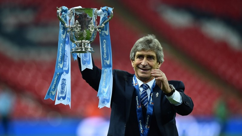 Manchester City's Chilean manager Manuel Pellegrini holds up the League Cup after the presentation after Manchester City won the penalty shoot-out to win the English League Cup final football match between Liverpool and Manchester City at Wembley Stadium in London on February 28, 2016. / AFP / BEN STANSALL / RESTRICTED TO EDITORIAL USE. No use with unauthorized audio, video, data, fixture lists, club/league logos or 'live' services. Online in-match use limited to 75 images, no video emulation. No use in betting, games or single club/league/player publications.  /
