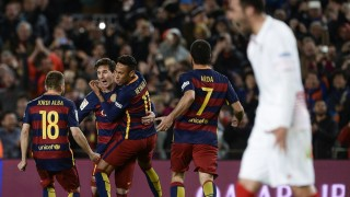 Barcelona's Argentinian forward Lionel Messi (2nd L) celebrates a goal with Barcelona's Brazilian forward Neymar (3rd L) and other teammates during the Spanish league football match FC Barcelona vs Sevilla FC at the Camp Nou stadium in Barcelona on February 28, 2016. / AFP / JOSEP LAGO